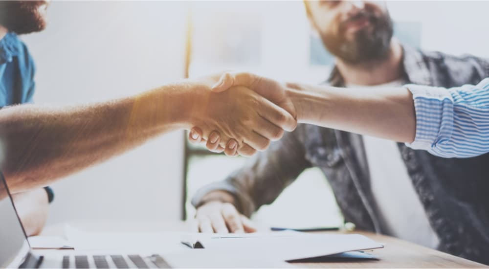 Business partnership handshake concept.Photo two coworkers handshaking process.Successful deal after great meeting